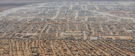 An aerial view shows the Zaatari refugee camp on Thursday, July 18, 2013 near the Jordanian city of Mafraq, some 8 kilometers from the Jordanian-Syrian border. Visiting the Zaatari refugee camp in northern Jordan, Kerry met six representatives of its 115,000-strong population, all of whom appealed to him to create no-fly zones and set up humanitarian safe havens inside Syria. The Obama administration has boosted assistance to the Syrian opposition but has noted grave complications and astronomic costs in enforcing no-fly zones or protecting the opposition on Syrian soil.(AP Photo/Mandel Ngan, Pool)
